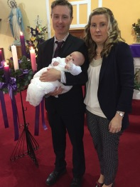 Ross Lorcan Mulconry with his parents Monica and Robert on his baptism day.